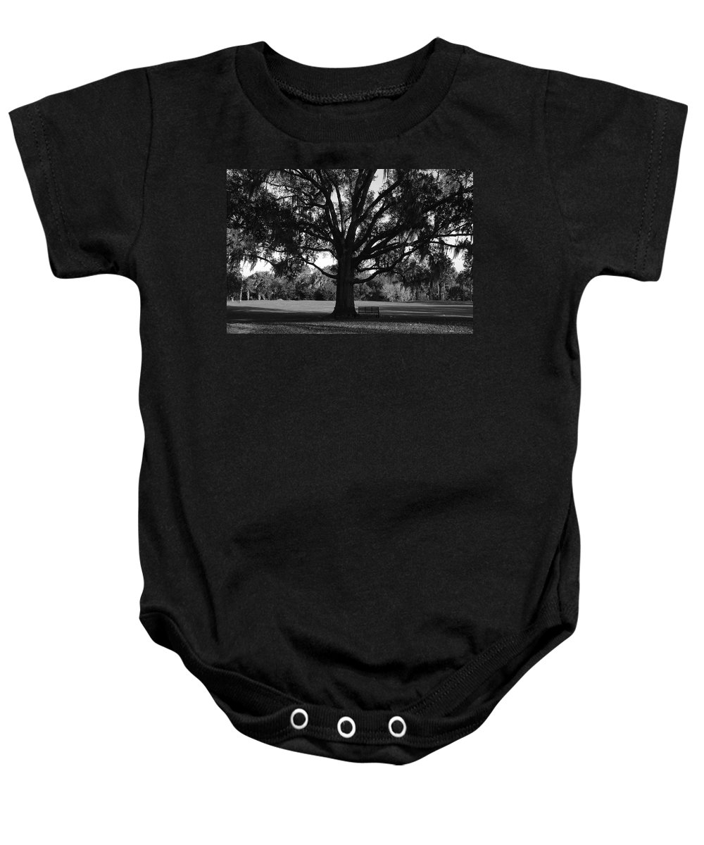 Park Bench Baby Onesie featuring the photograph Bench Under Oak by David Lee Thompson