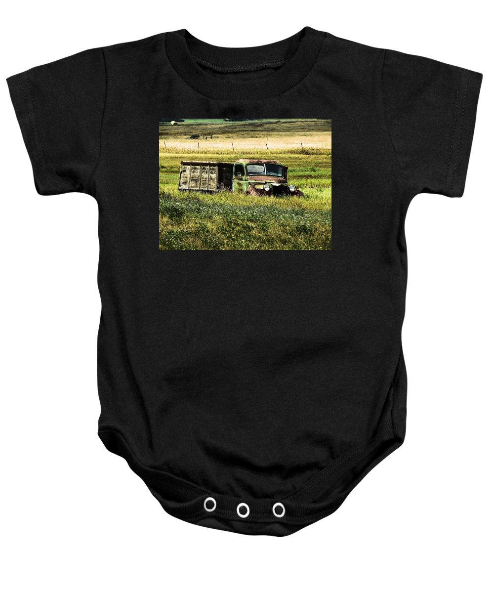Truck Baby Onesie featuring the photograph Bereft In A Field by Jeff Swan