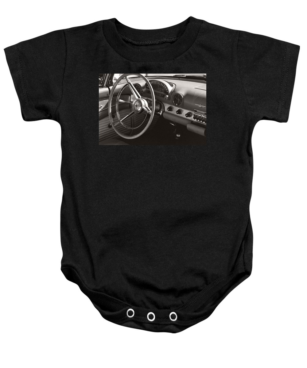 Black Baby Onesie featuring the photograph Black And White Thunderbird Steering Wheel And Dash by Heather Kirk