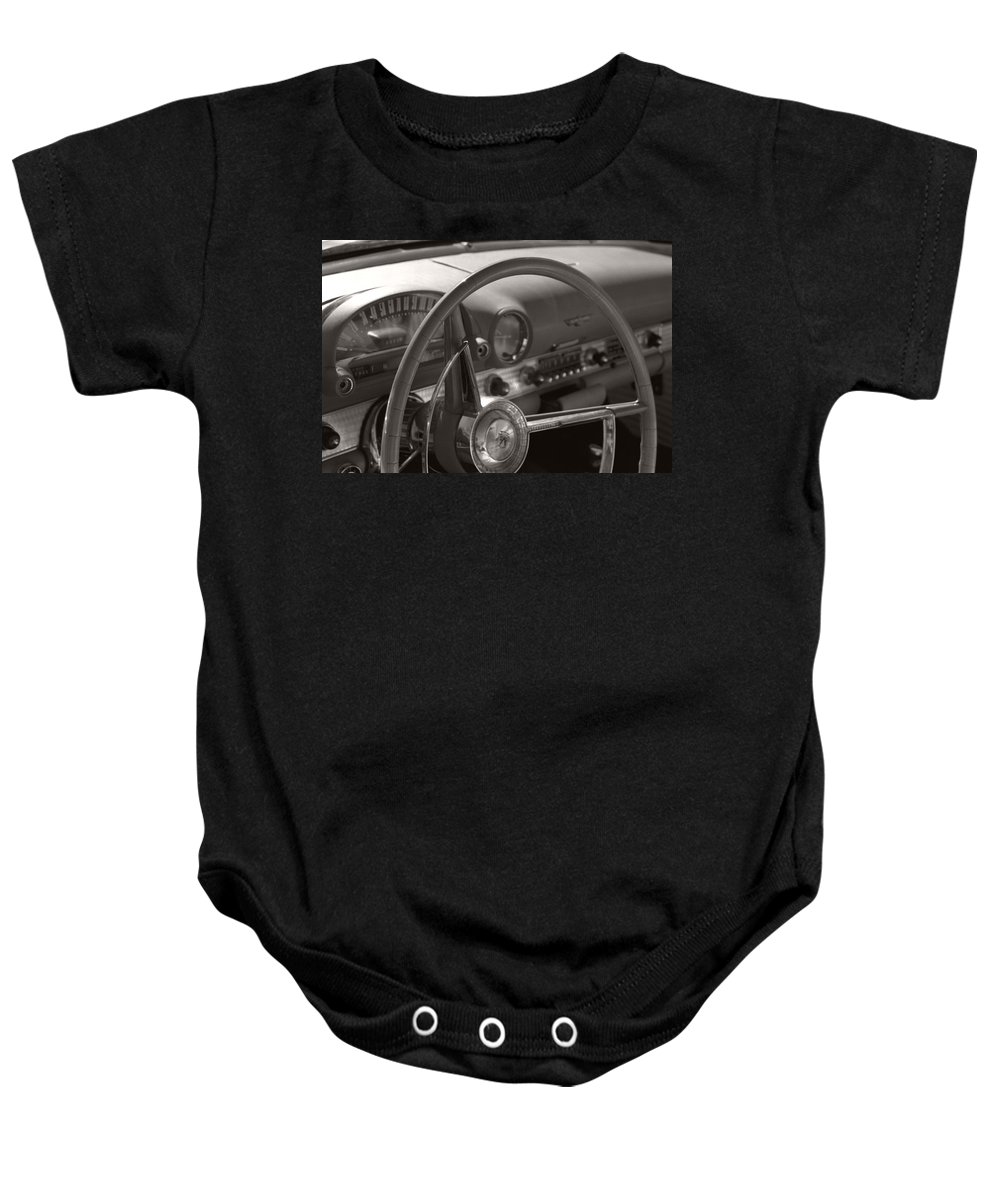 Black And White Photography Baby Onesie featuring the photograph Black And White Thunderbird Steering Wheel by Heather Kirk