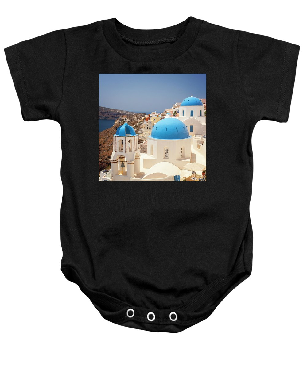 White Baby Onesie featuring the photograph Blue Domed Churches Santorini by Sophie McAulay