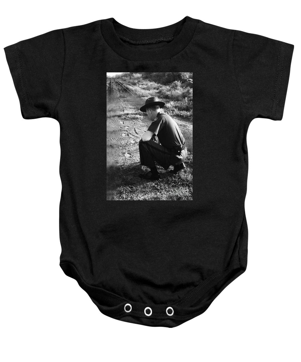 1957 Baby Onesie featuring the photograph Border Patrol Inspector by Granger