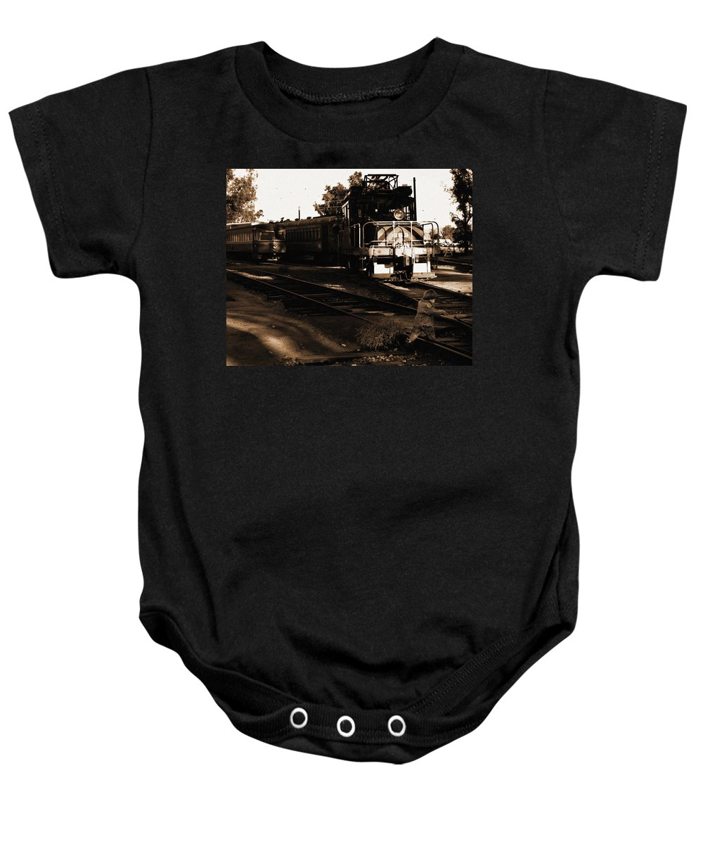 Train Baby Onesie featuring the photograph Boy On The Tracks by Anthony Jones