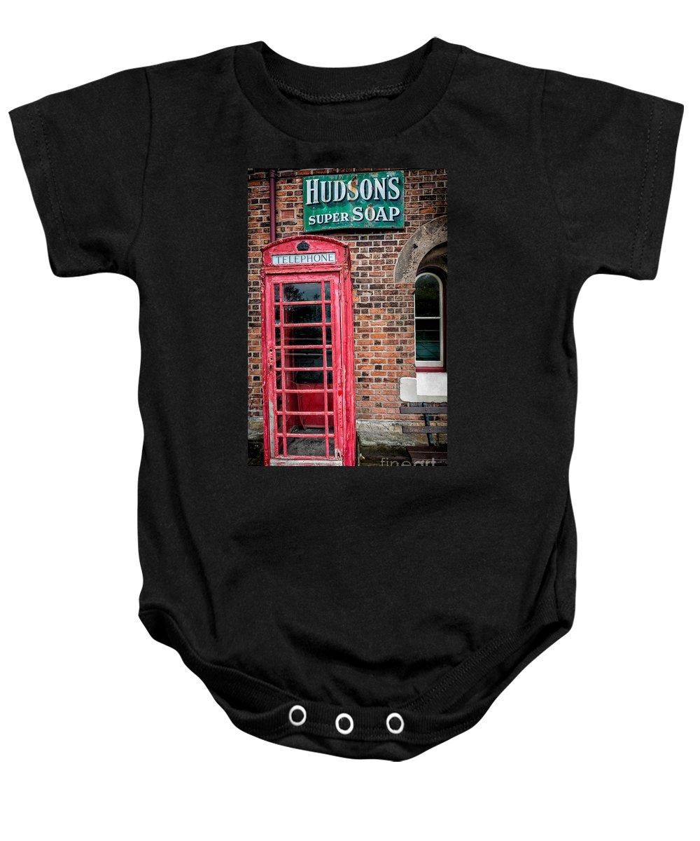 British Baby Onesie featuring the photograph British Phone Box by Adrian Evans