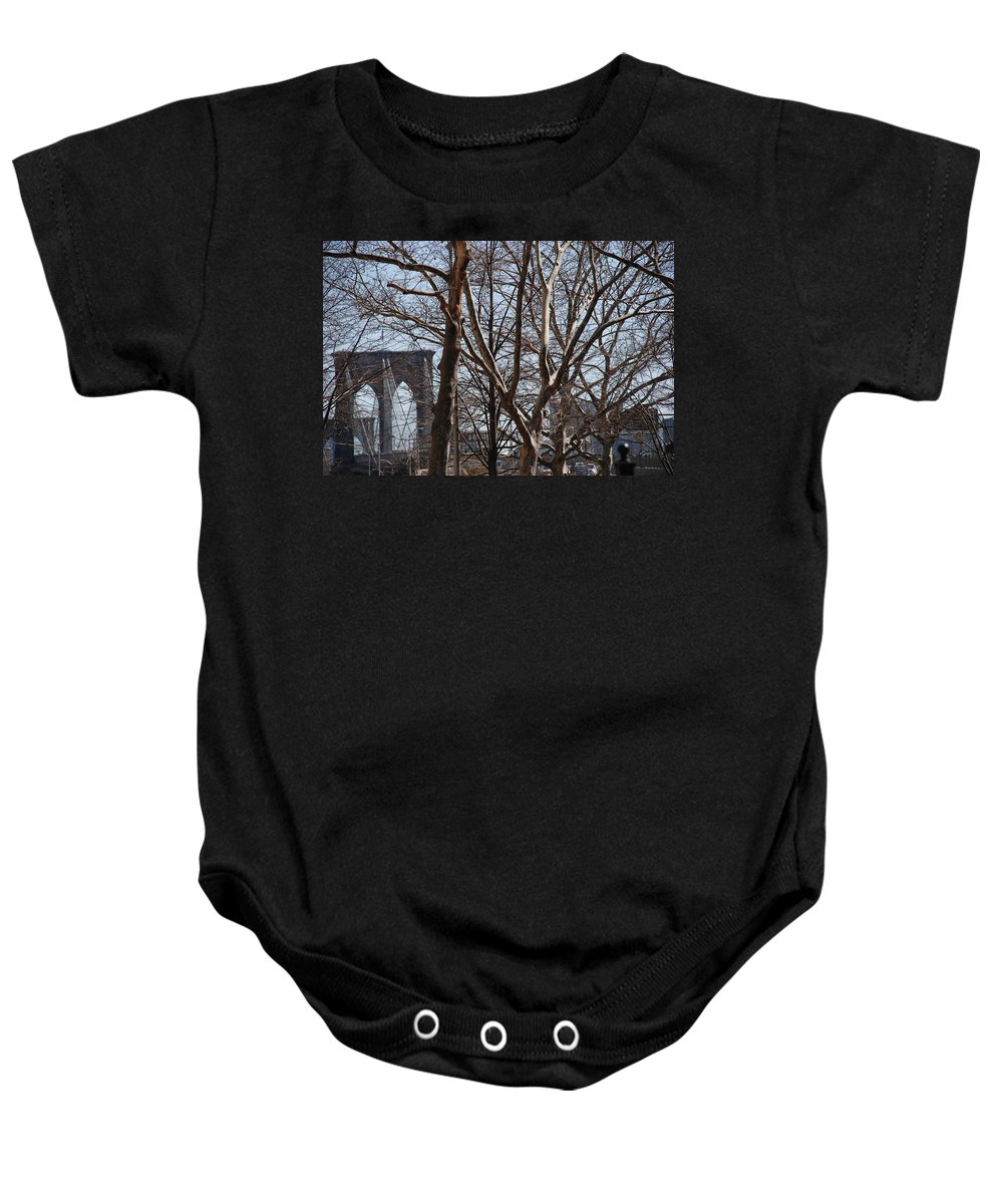 Architecture Baby Onesie featuring the photograph Brooklyn Bridge Thru The Trees by Rob Hans