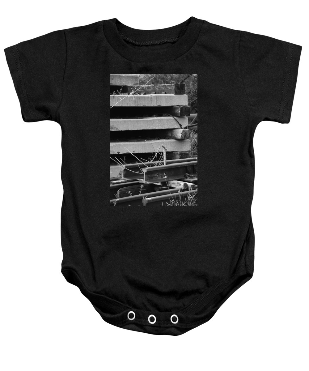 Black And White Baby Onesie featuring the photograph Building Tracks by Rob Hans
