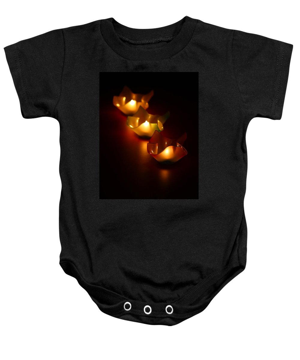 Blur Baby Onesie featuring the photograph Candleworks by Evelina Kremsdorf
