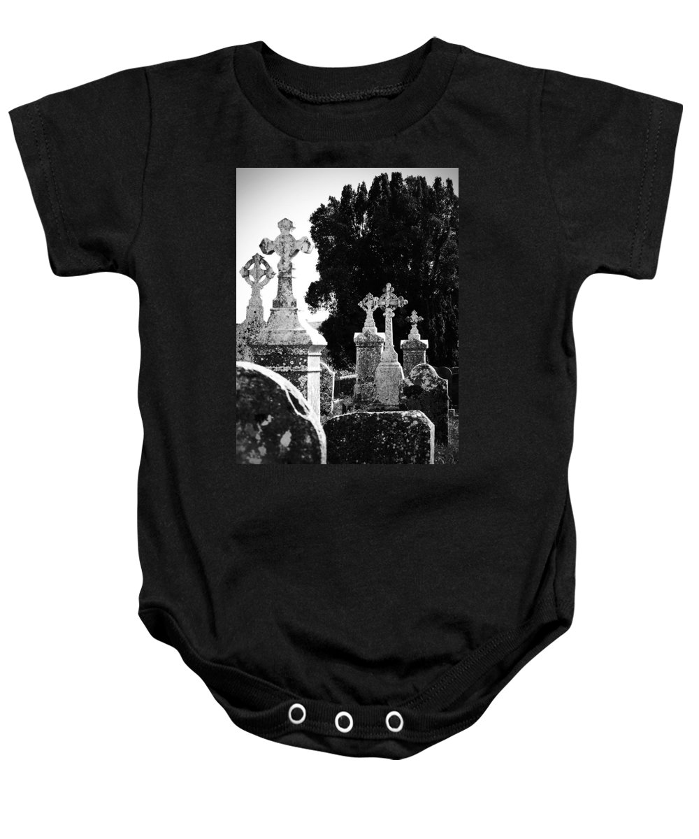 Celtic Baby Onesie featuring the photograph Celtic Crosses At Fuerty Cemetery Roscommon Ireland by Teresa Mucha