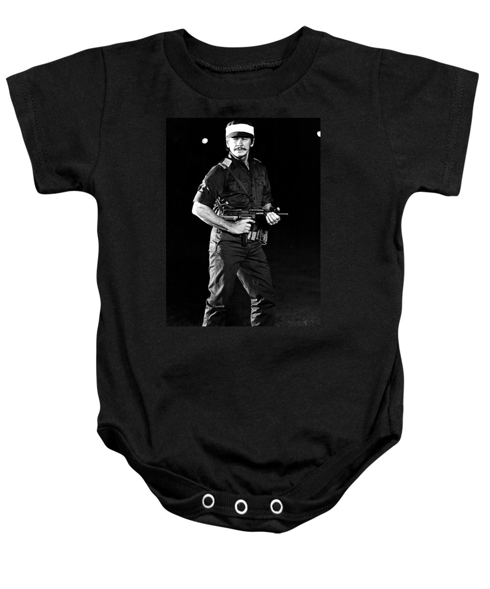 Publicity Photo Baby Onesie featuring the photograph Charles Bronson In Raid On Entebbe 1977 by Mountain Dreams