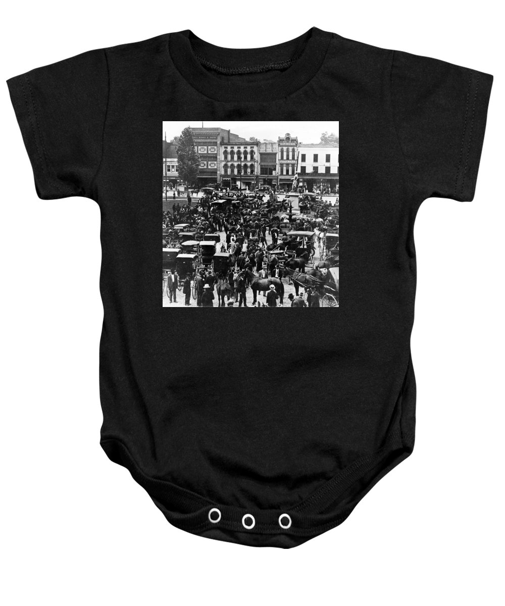 Kentucky Baby Onesie featuring the photograph Cheapside Public Square In Lexington - Kentucky - April 7 1920 by International Images