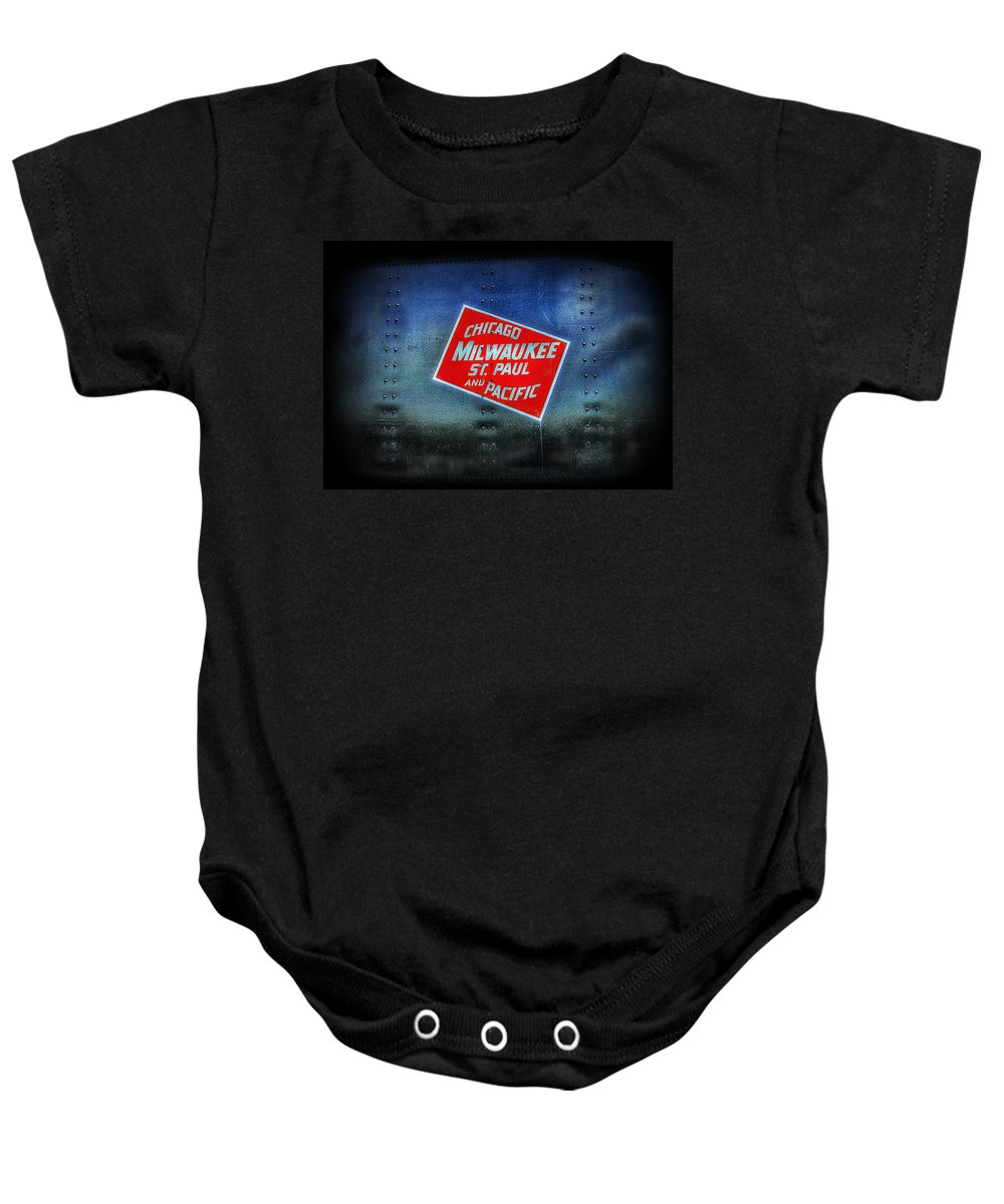 Todd Carter Chicago Milwaukee St. Paul And Pacific Sign Advertisement Train Metal Rivets Paint Rust Metallic Red Grey White Blue Black Rough Rail Road  Baby Onesie featuring the photograph Chicago Milwaukee St. Paul And Pacific by Todd Carter
