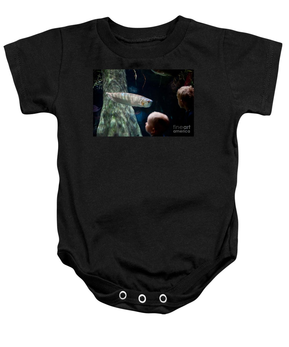 Silver Arowana Baby Onesie featuring the photograph Children Watch Silver Arowana Fish by Arletta Cwalina