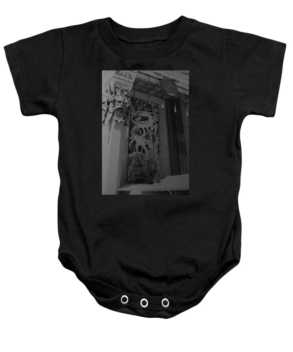 Black And White Baby Onesie featuring the photograph Chinese Theater by Rob Hans