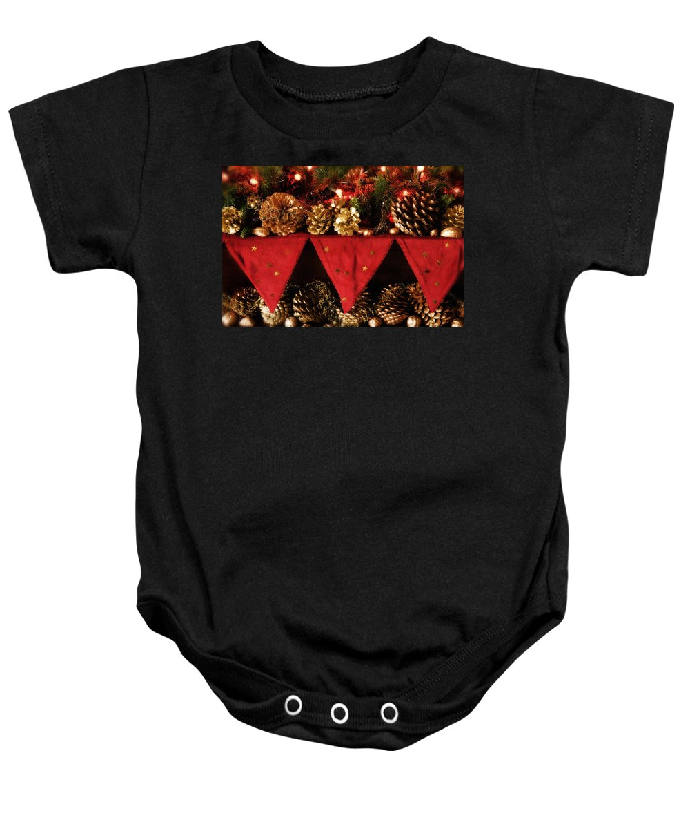 Christmas Baby Onesie featuring the photograph Christmas Decorations Of Garlands And Pine Cones by Mal Bray