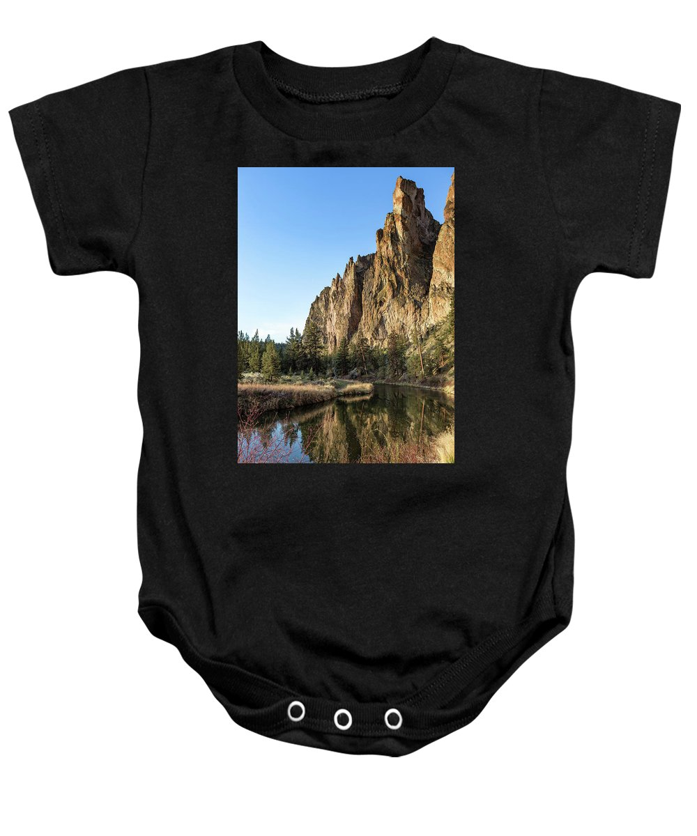 Smith Rock Baby Onesie featuring the photograph Cliffs Above Crooked River by Belinda Greb