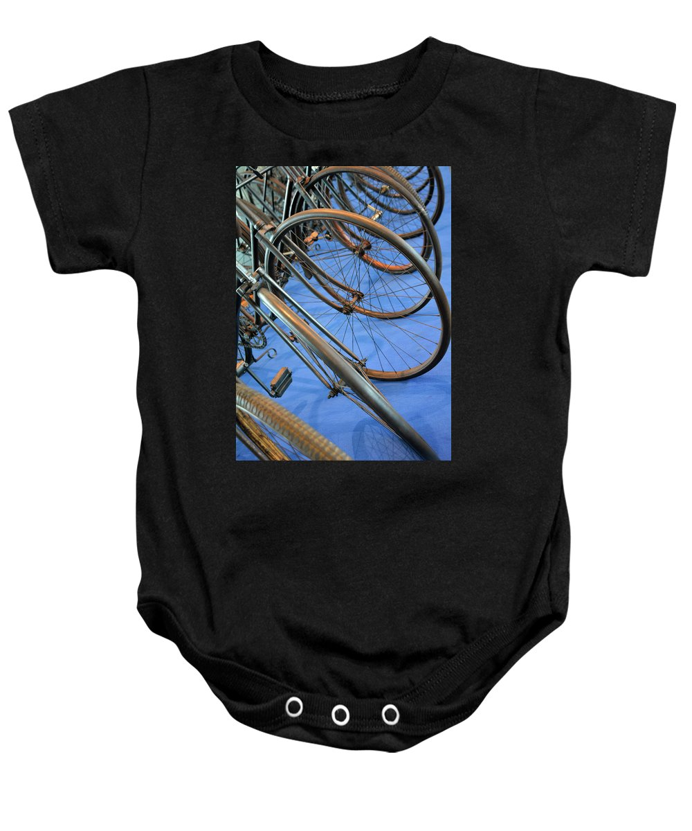 Bicycle Baby Onesie featuring the photograph Close Up On Many Wheels From Bicycles by Oana Unciuleanu