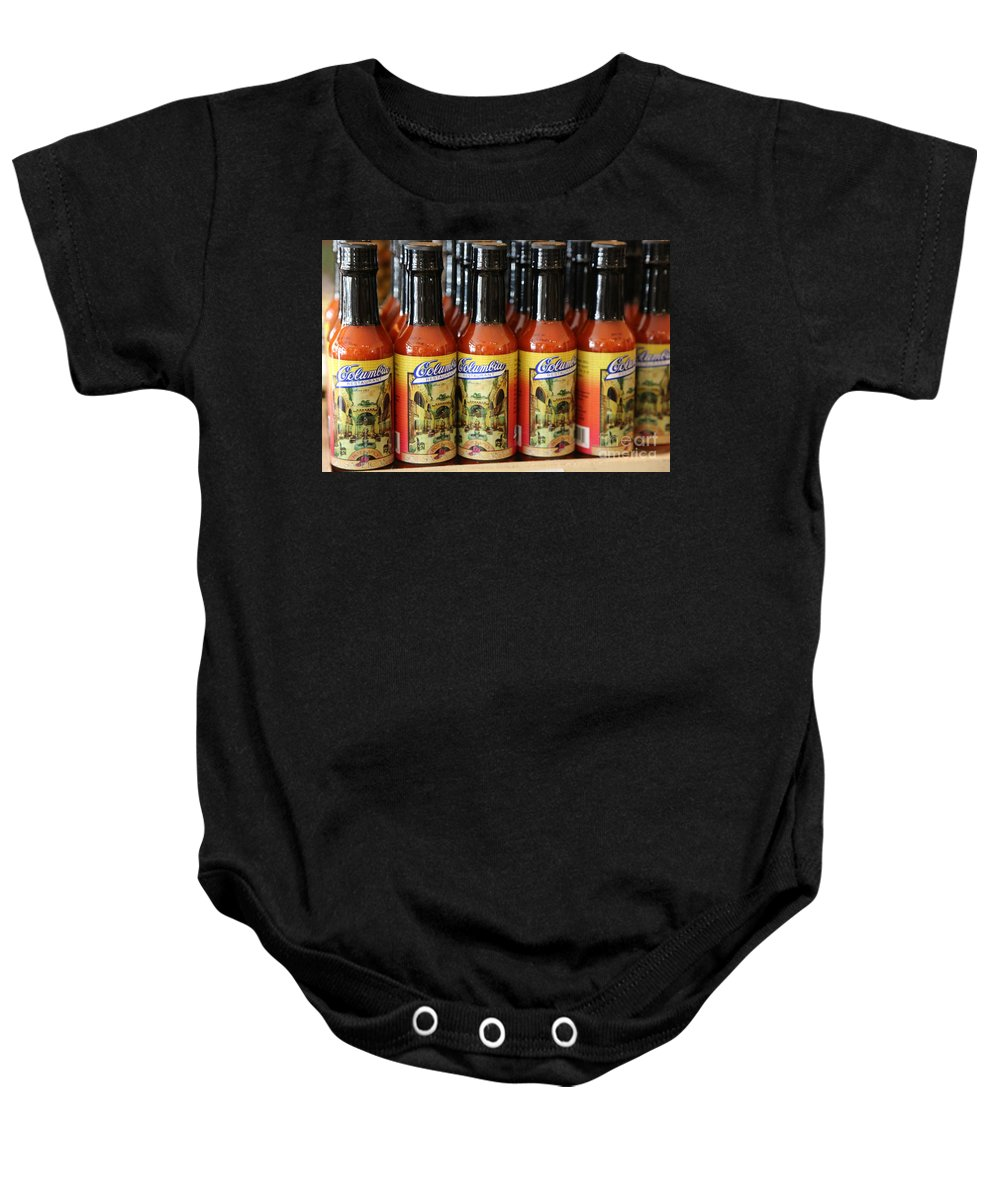 Hot Sauce Baby Onesie featuring the photograph Columbia Restaurant Hot Sauce by Carol Groenen