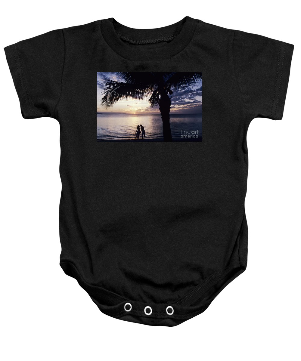 Black Baby Onesie featuring the photograph Couple Silhouetted On Beach by Larry Dale Gordon - Printscapes