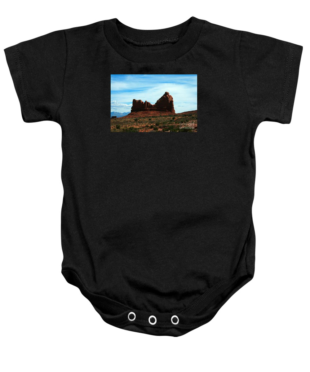 Courthouse Rock Baby Onesie featuring the painting Courthouse Rock In Arches National Park by Corey Ford