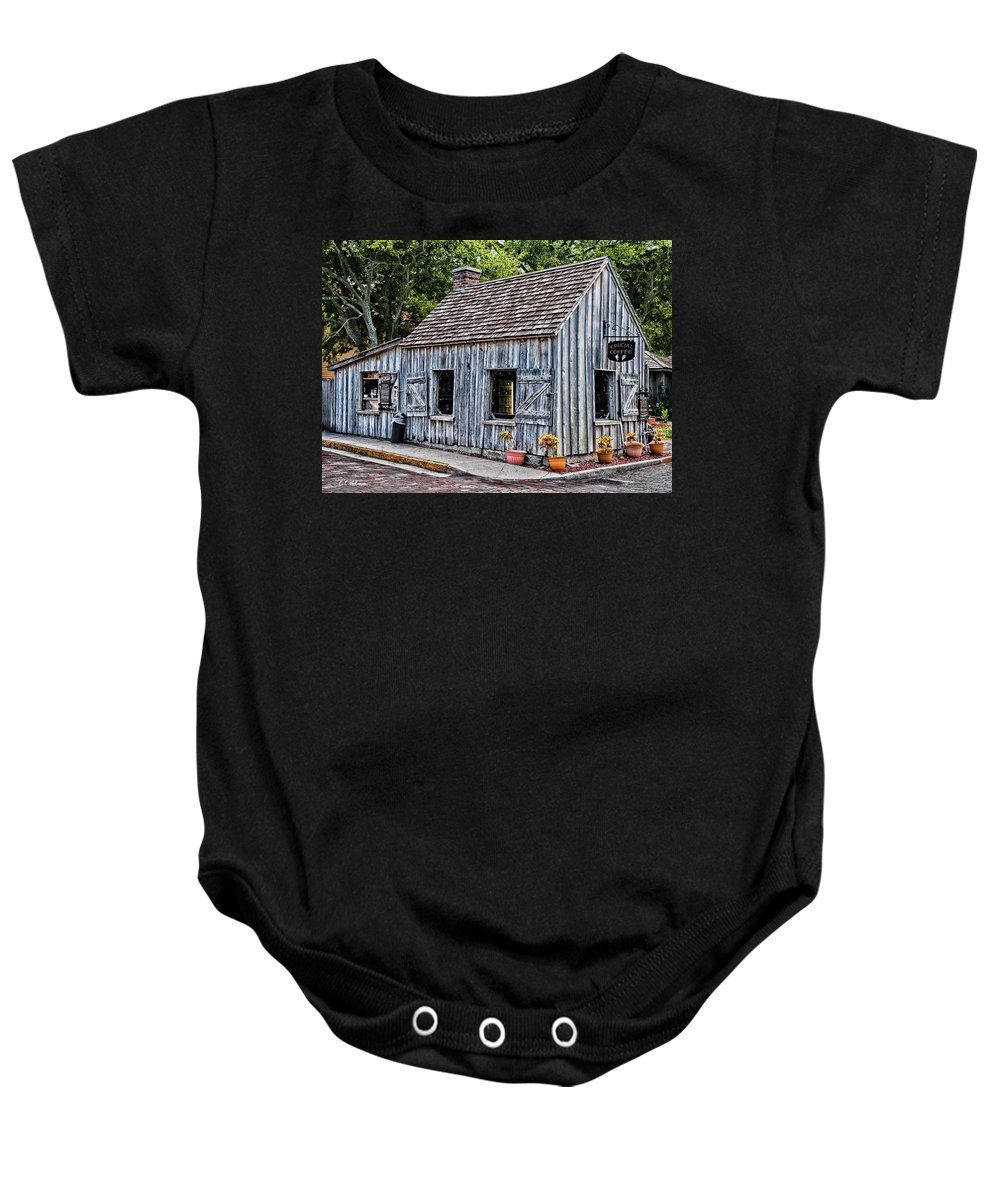 Structure Baby Onesie featuring the photograph Crucial Coffee by Christopher Holmes