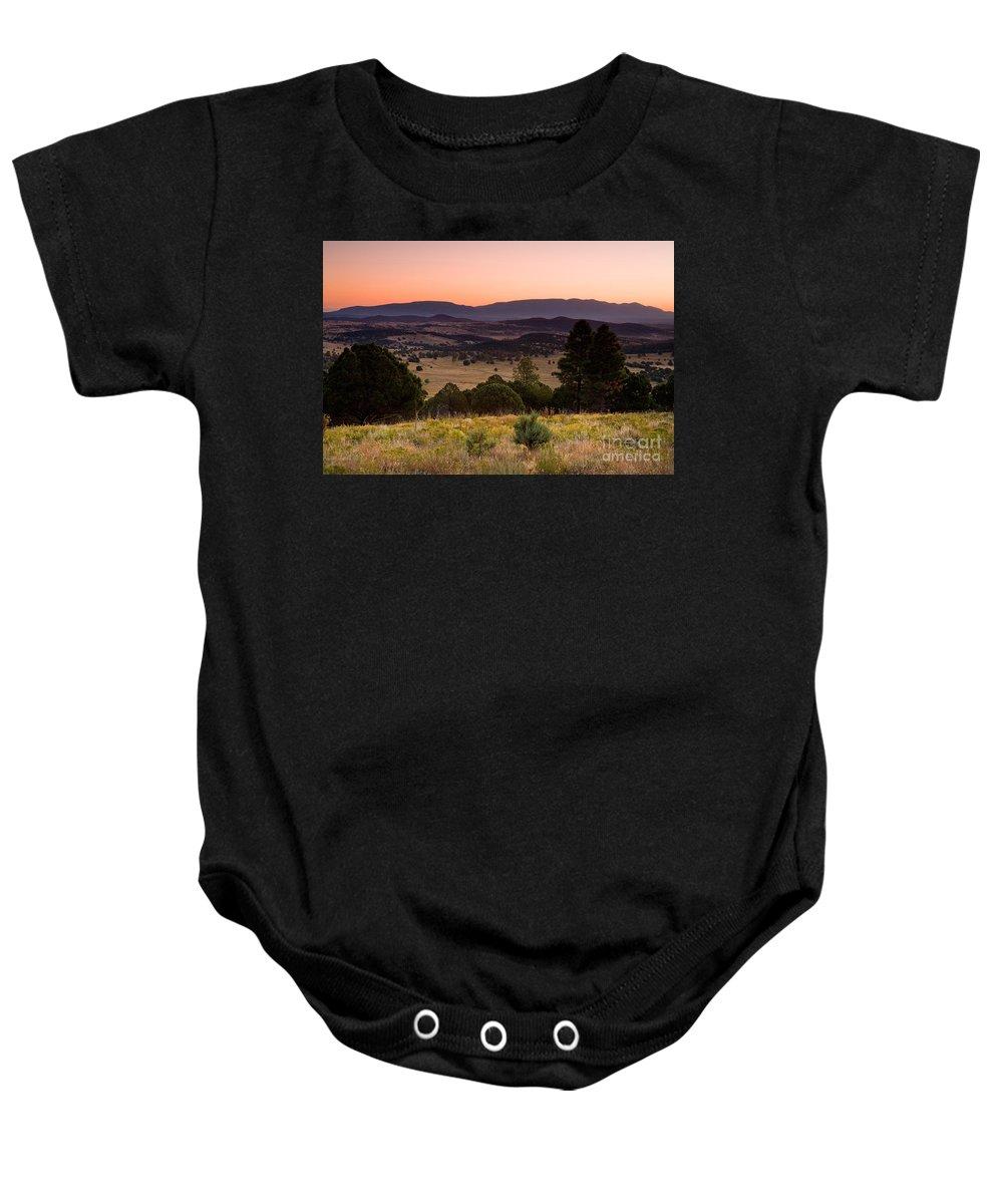 Dawn Baby Onesie featuring the photograph Dawn Near Ruidoso New Mexico by Matt Suess