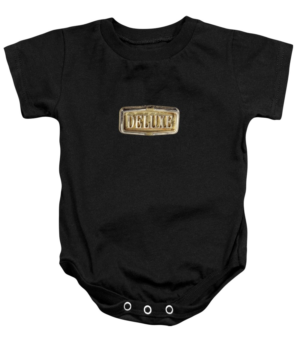 Automotive Baby Onesie featuring the photograph Deluxe Chrome Emblem by YoPedro