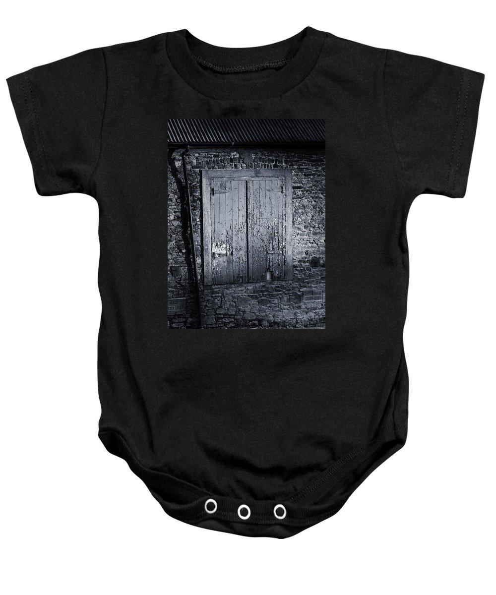 Irish Baby Onesie featuring the photograph Door To Nowhere Blarney Ireland by Teresa Mucha