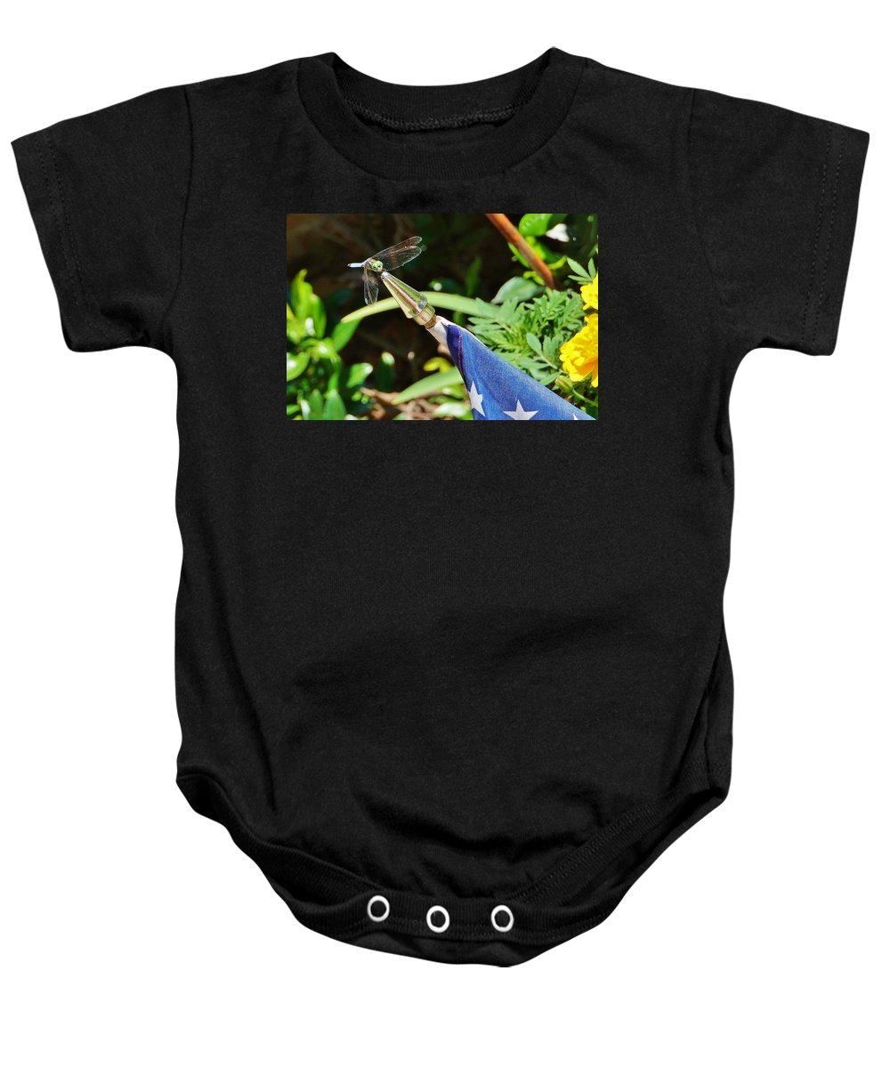 Dragonfly Baby Onesie featuring the photograph Dragonfly On Flag by Beth Deitrick