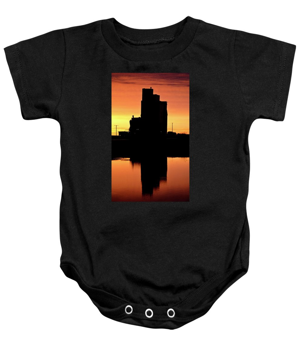 Twilight Baby Onesie featuring the digital art Eyebrow Gain Elevator Reflected Off Water After Sunset by Mark Duffy