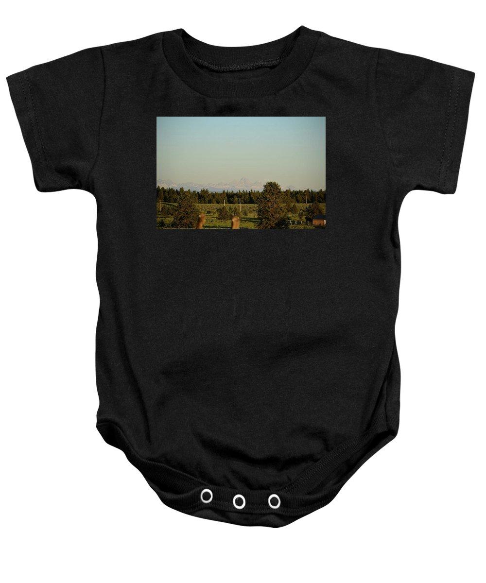 Tetons Baby Onesie featuring the photograph Faint Tetons by Dora Stratton