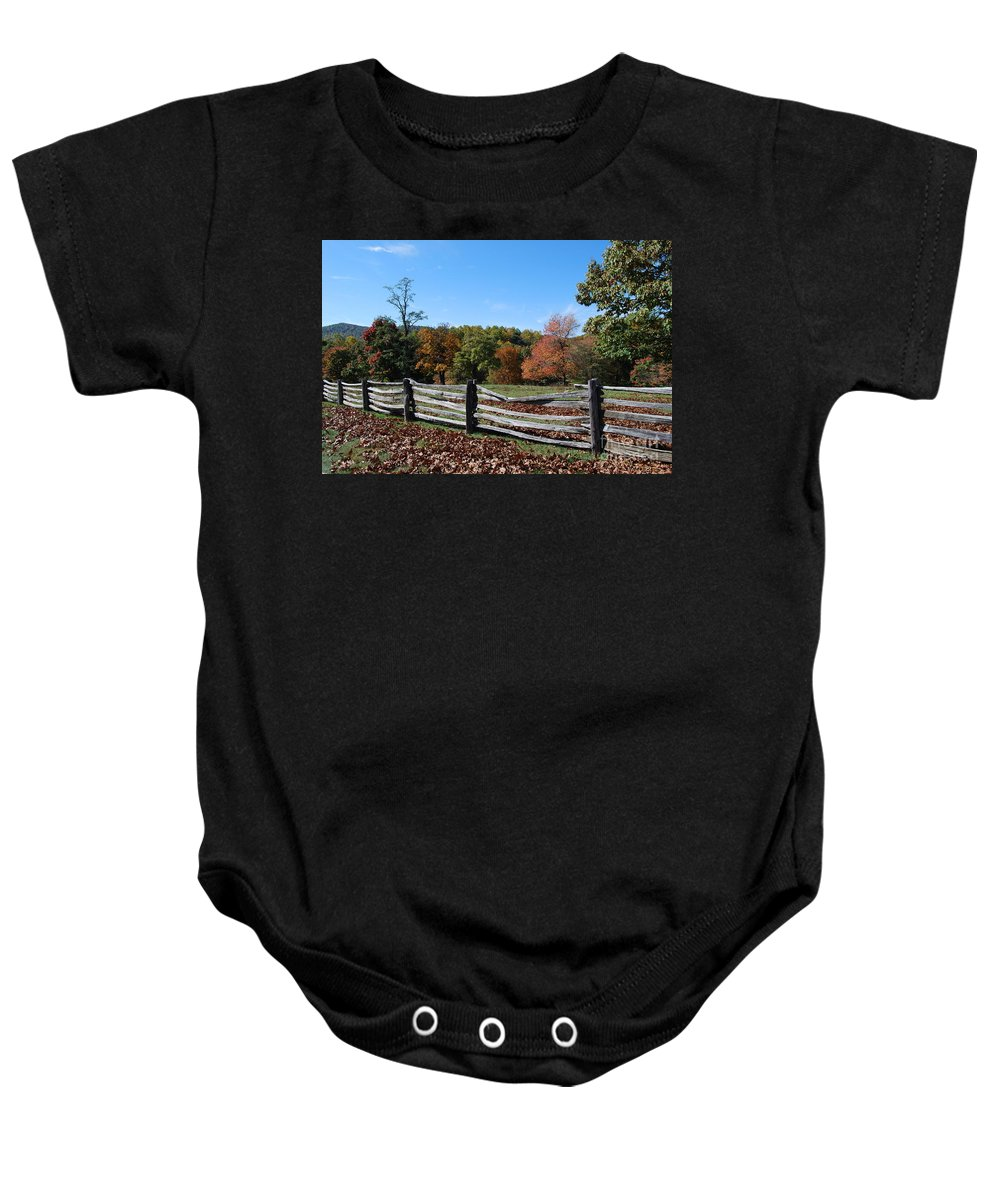 Rural Baby Onesie featuring the photograph Fall fence by Eric Liller