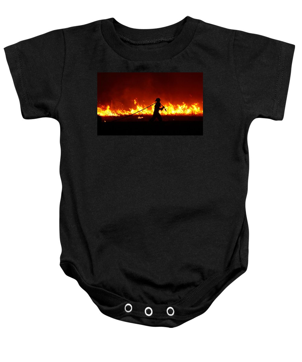 Fire Baby Onesie featuring the digital art Fighting The Fire by Linda Unger