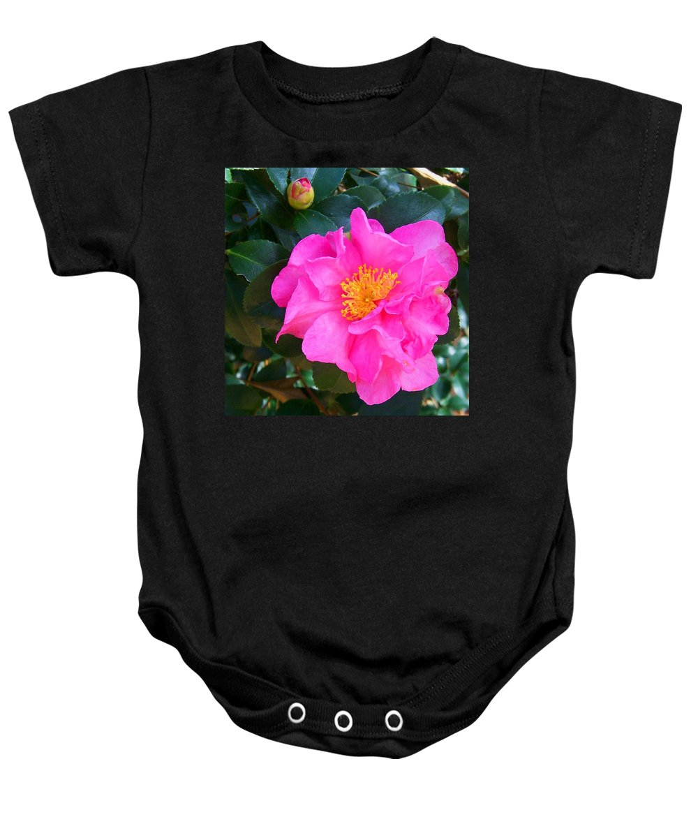 Camelia Baby Onesie featuring the photograph Firey Pink Camelia by Laurie Paci