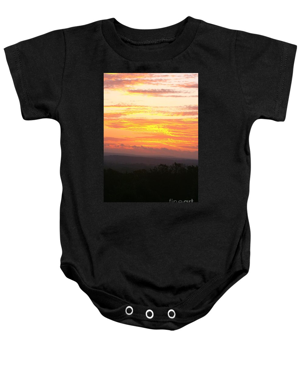 Sunrise Baby Onesie featuring the photograph Flaming Autumn Sunrise by Nadine Rippelmeyer
