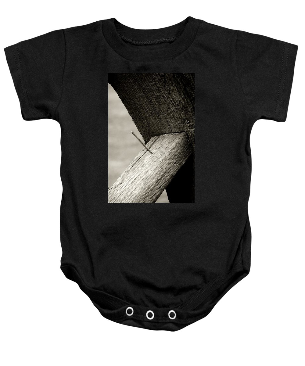 Baby Onesie featuring the photograph For Want Of A Nail by RC DeWinter