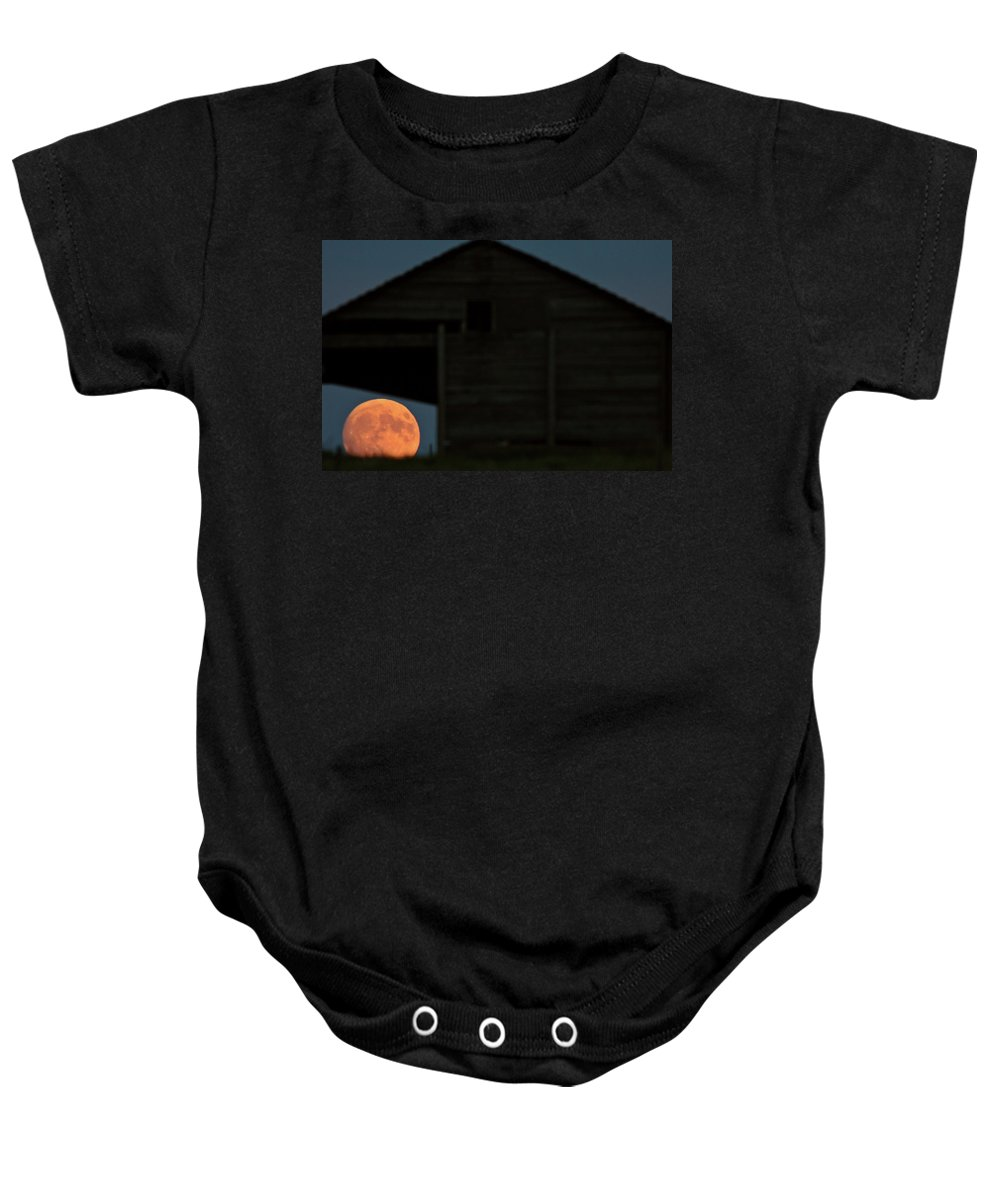 Building Baby Onesie featuring the digital art Full Moon Seen Through Old Building Window by Mark Duffy