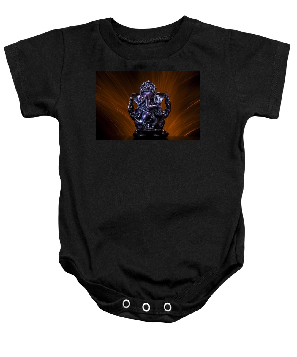 Ganesha Deity Revered Remover Obstacles Patron Arts Sciences Deva Intellect Wisdom God Beginnings Baby Onesie featuring the photograph Ganesha With Fire Background by Pelo Blanco Photo