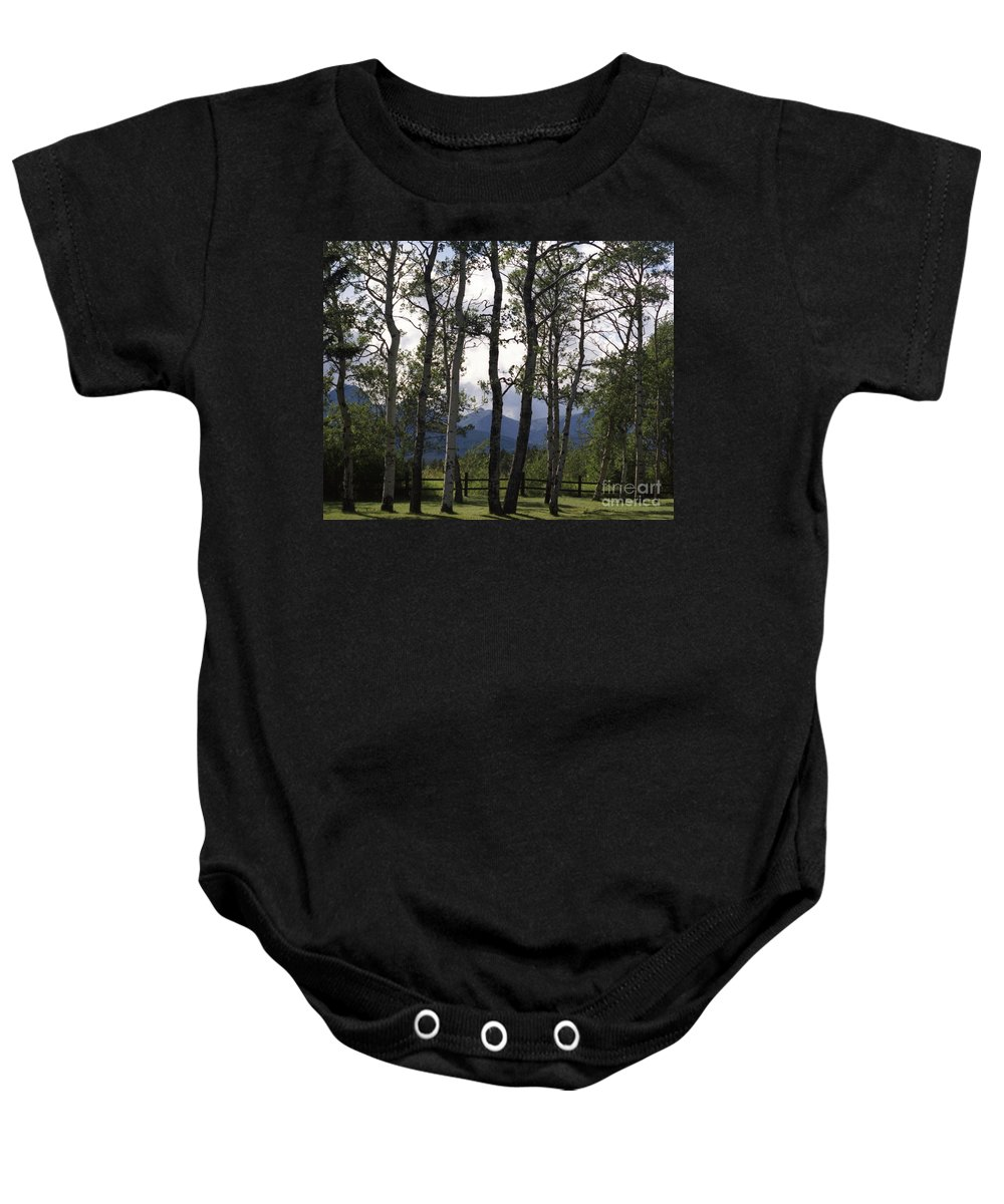 Baby Onesie featuring the photograph Glacier National Park Green Trees Mountains by Heather Kirk