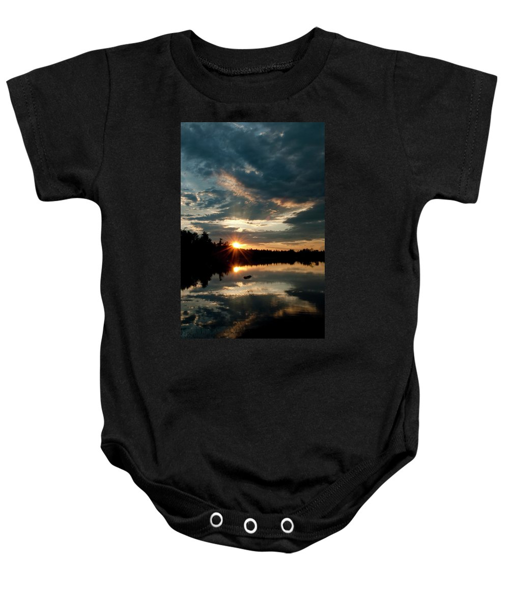 Candia Baby Onesie featuring the photograph Going Going by Greg Fortier