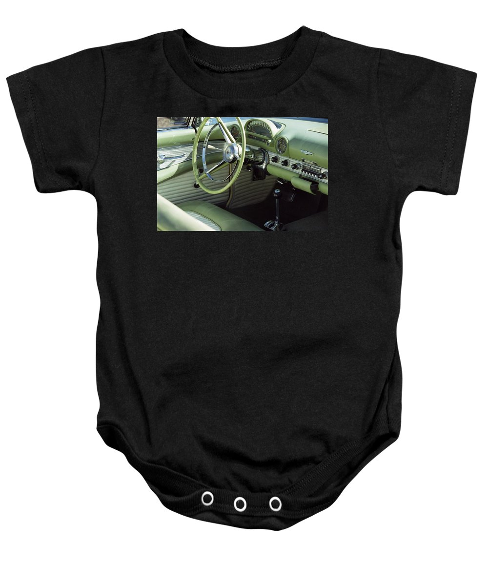 Photography Baby Onesie featuring the photograph Green Thunderbird Wheel And Front Seat by Heather Kirk