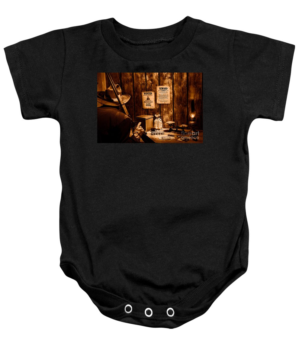 Western Baby Onesie featuring the photograph Guarding The Payroll - Sepia by Olivier Le Queinec