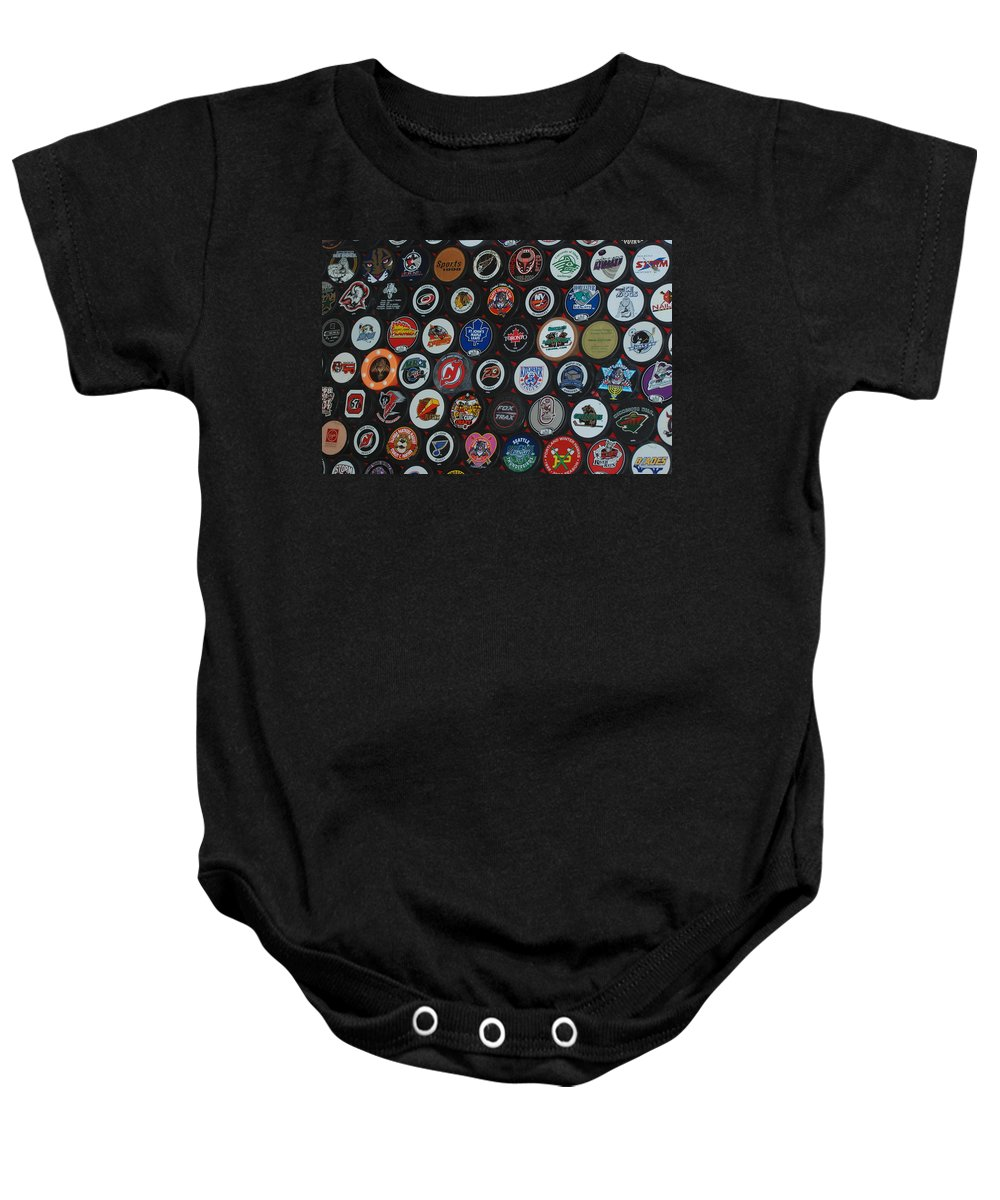 Pop Art Baby Onesie featuring the photograph Hockey Pucks by Rob Hans