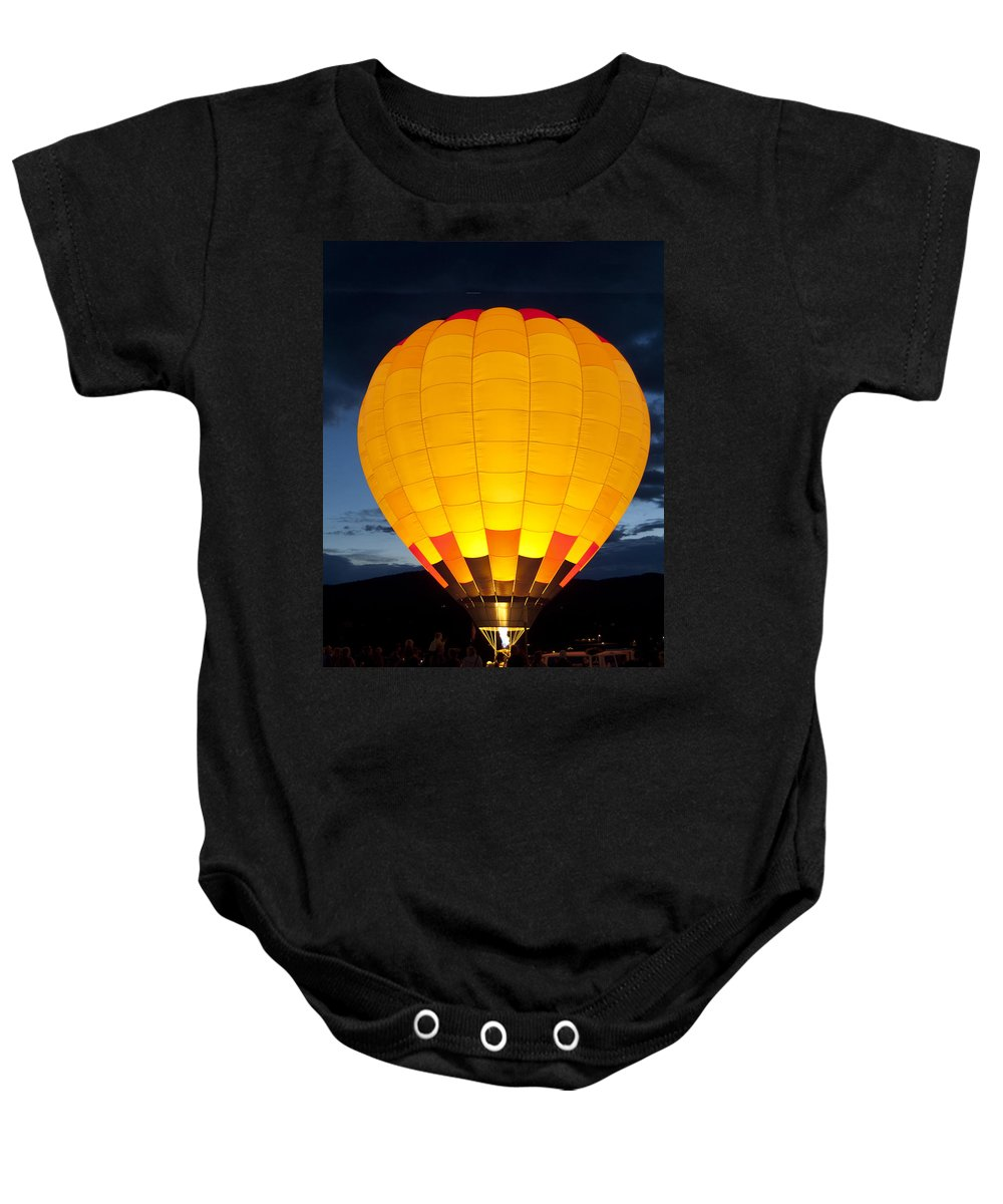 Hot Air Balloon Glow Baby Onesie featuring the photograph Hot Air Balloon Glow by Gary Langley