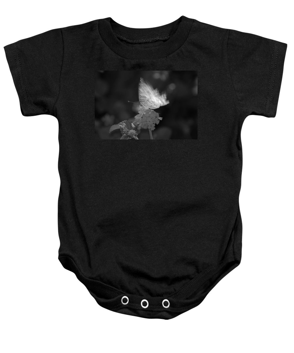 Black And White Baby Onesie featuring the photograph In Motion by Rob Hans