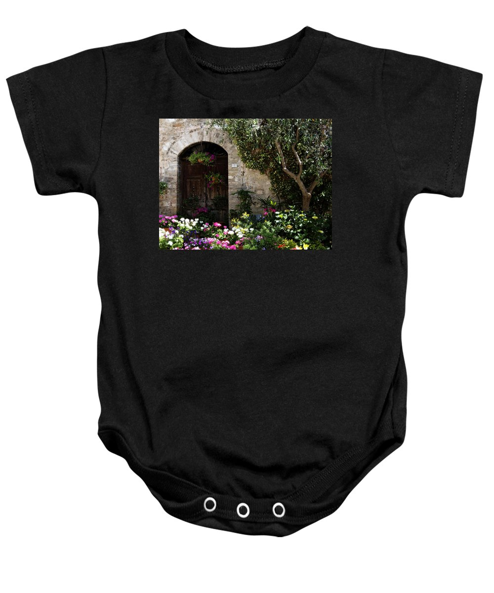 Flower Baby Onesie featuring the photograph Italian Front Door Adorned With Flowers by Marilyn Hunt
