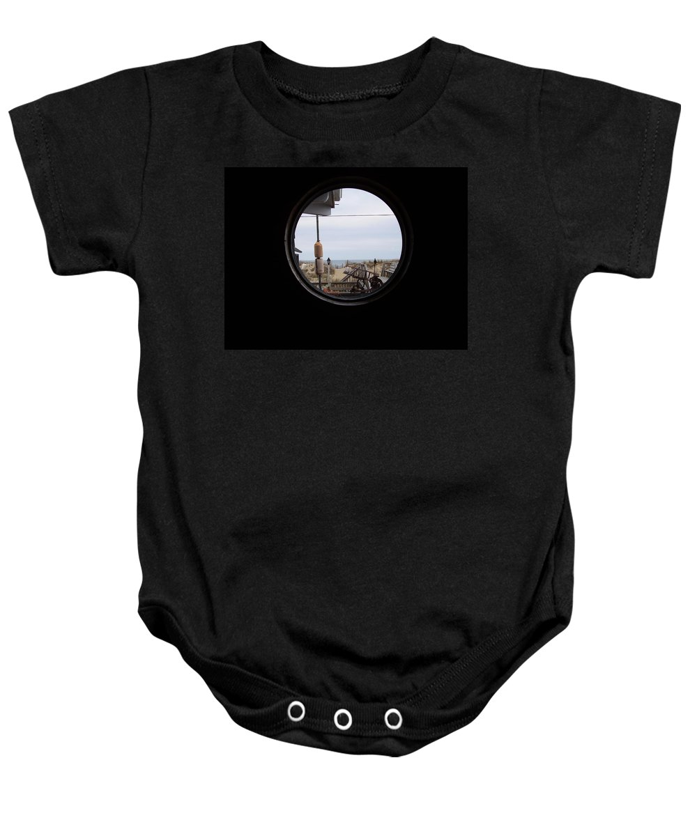 Kitty Hawk Baby Onesie featuring the photograph Kitty Hawk by Flavia Westerwelle