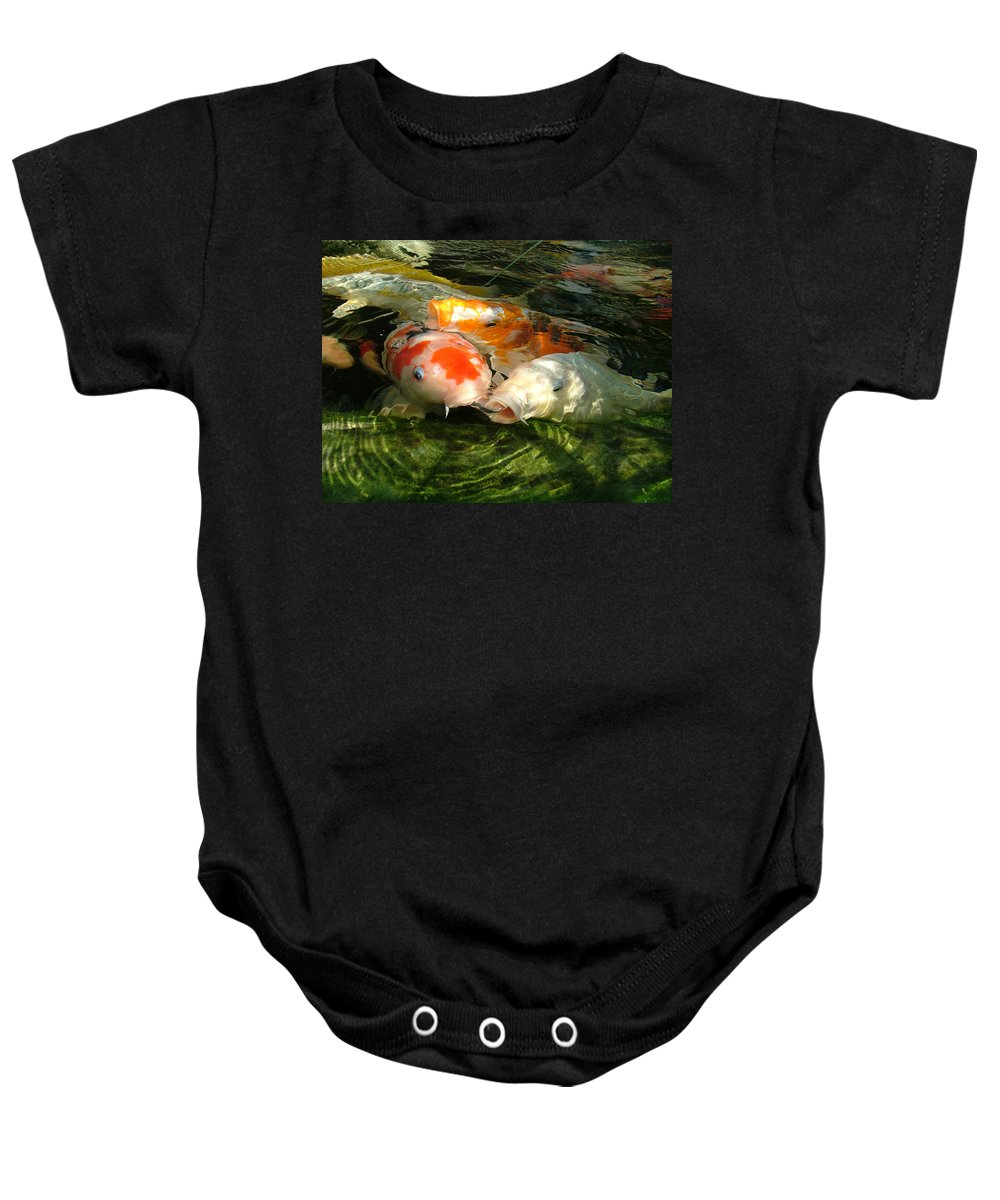 Koi Baby Onesie featuring the photograph Koi Ripples by Heather Lennox