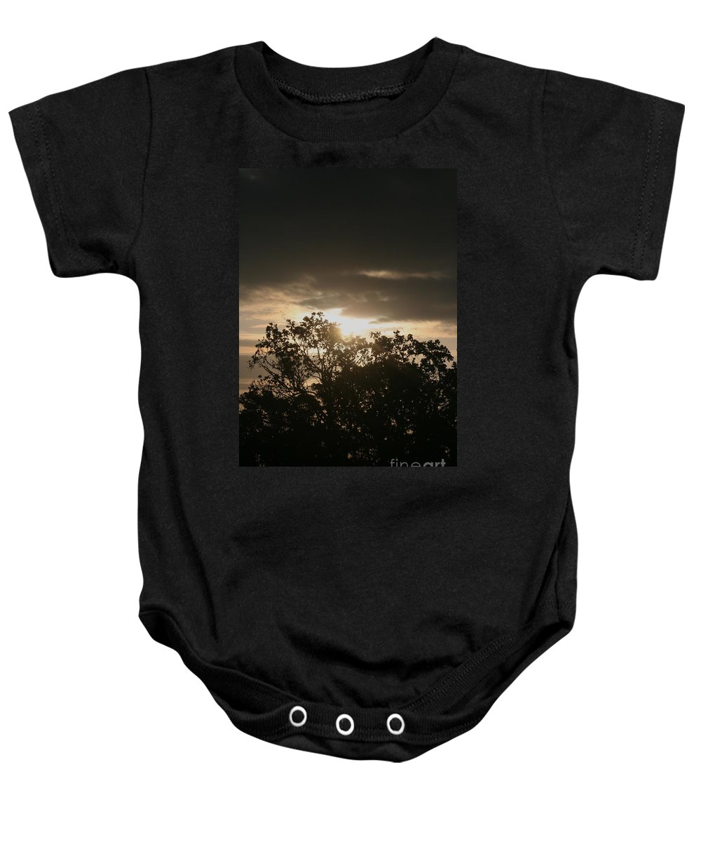 Light Baby Onesie featuring the photograph Light Chasing Away The Darkness by Nadine Rippelmeyer