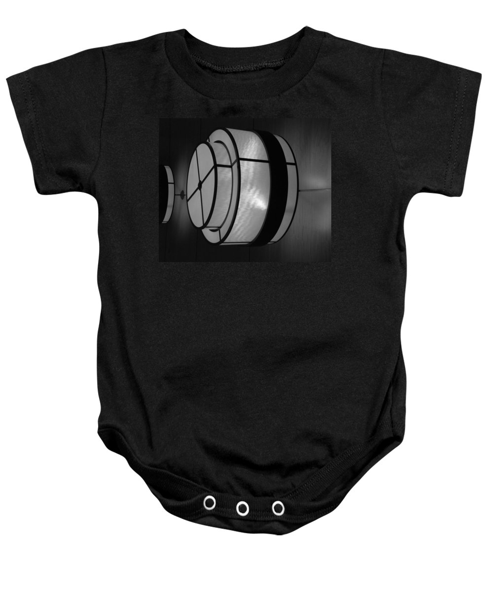 Black And White Baby Onesie featuring the photograph Lighted Wall In Black And White by Rob Hans