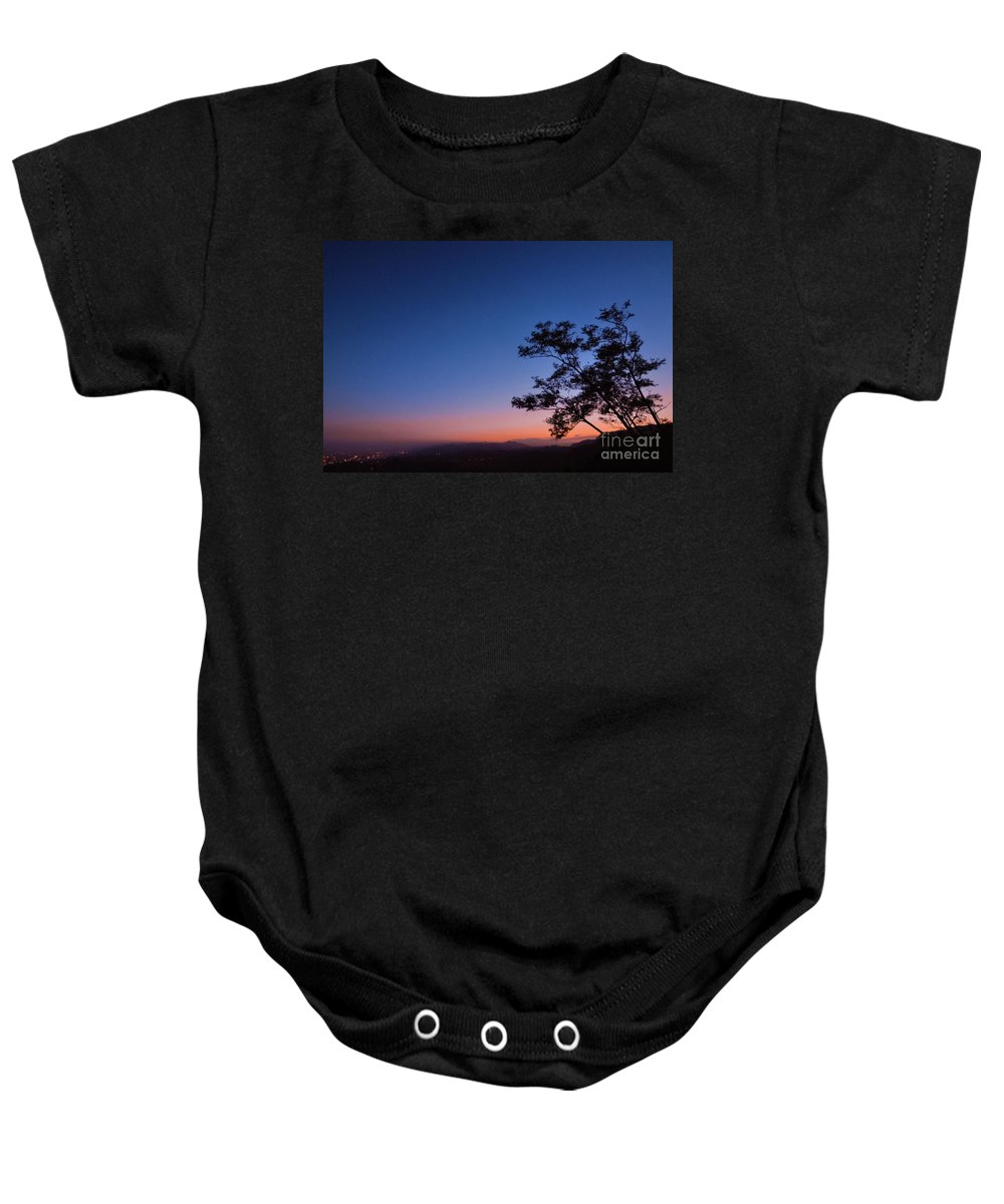 Backlit Trees Baby Onesie featuring the photograph Los Angeles At Night by Brooke Meislik